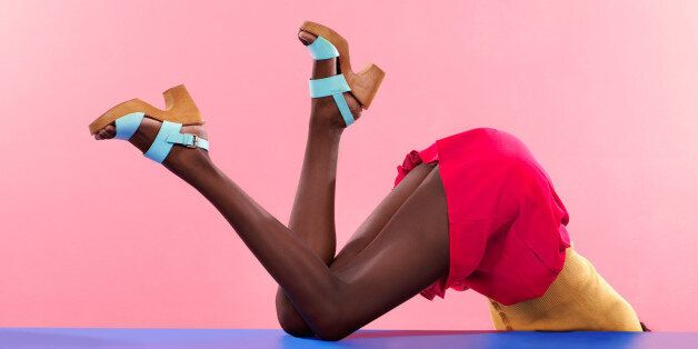 Cropped shot of footwear on a colourful