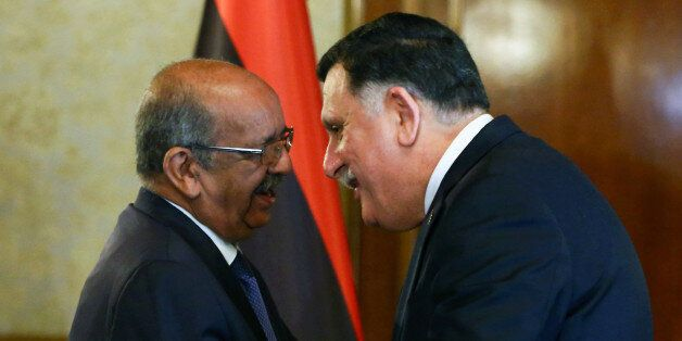 Algeria's Minister Delegate for Maghreb and African Affairs, Abdelkader Messahel (L), shakes hands with...