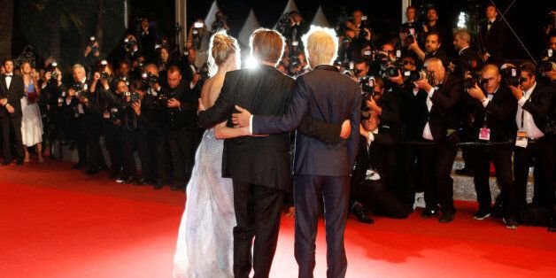 Actor and director Sean Penn poses with his children actor Hopper Jack Penn (R) and actress Dylan Penn...