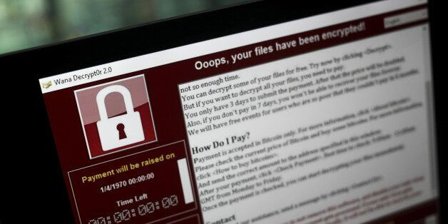 A lock screen from a cyber attack warns that data files have been encrypted on a laptop computer in this...