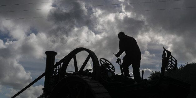 EXETER, ENGLAND - MAY 18: A man oils his steam engine being displayed at the 122nd Devon County Show...