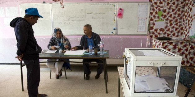 An Algerian man casts his vote at a polling station in the town of Blida, 45 kilometres (30 miles) southwest...