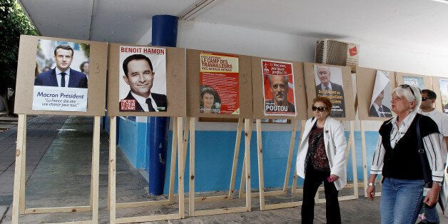 French citizens, who reside in Tunisia, arrive to cast their votes for French presidential election,...