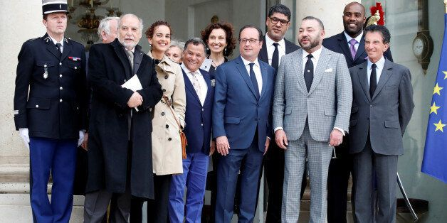 French President Francois Hollande (C) and Morocco's King Mohammed VI (2ndR) pose with guests after their...