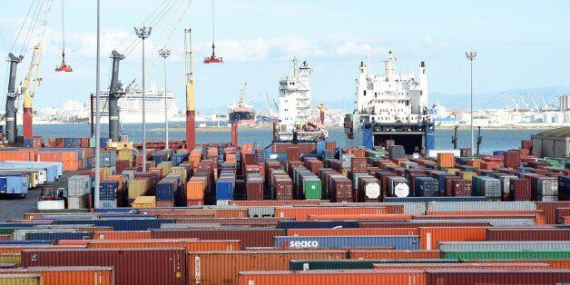 Cargo ships unload imported goods in the Tunisian port city of Rades on November 12, 2014. The World...