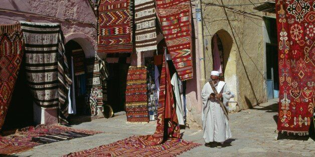 ALGERIA - MARCH 18: Carpet seller at market square, M'zab Valley (UNESCO World Heritage List, 1982),...