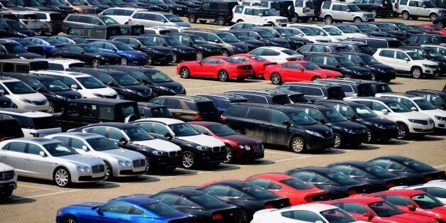 Imported cars are seen parked at a parking lot near a port in Qingdao, east China's Shandong province...