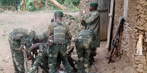 Congolese soldiers from the Armed Forces of the Democratic Republic of Congo (FARDC) assemble their ammunition...