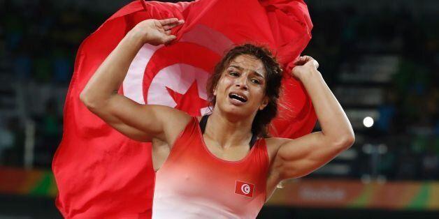 Tunisia's Marwa Amri celebrates after winning against Azerbaijan's Yuliya Ratkevich in their women's...