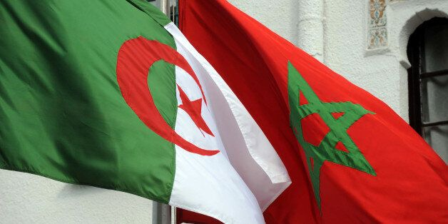 The flags of Algeria (L) and Morocco flutter as Algerian president greets Moroccan Foreign Minister on...