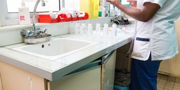 A picture taken on March 31, 2017 shows a nurse preparing medicines at the Centre Hospitalier Andree...