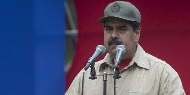 Nicolas Maduro, president of Venezuela, pauses while speaking during a ceremony with Militia members...