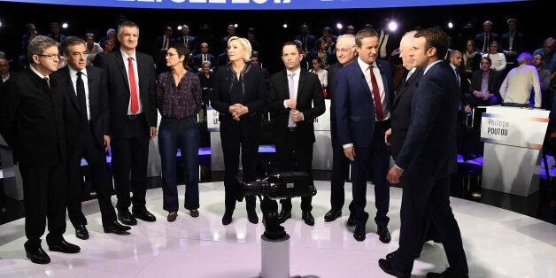 Candidates pose prior to a prime-time televised debate for the French 2017 presidential election in La...