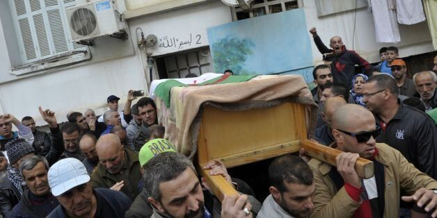 Relatives and friends leave the family house carrying the body of British-Algerian journalist Mohamed...
