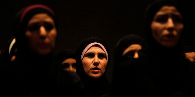 Syrian refugee women perform the