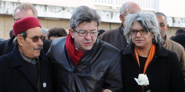 The widow of murdered Tunisian opposition figure Chokri Belaid, Basma Khalfaoui (R), his father Salah...