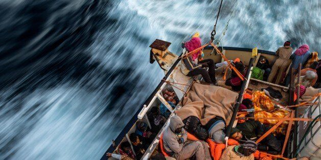 Refugees and migrants sleep on the deck of the Spanish NGO Proactiva Open Arms rescue vessel Golfo Azzurro...