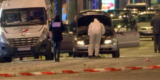 A still image from video footage shows Police investigators inspect the car used by the attacker on the...
