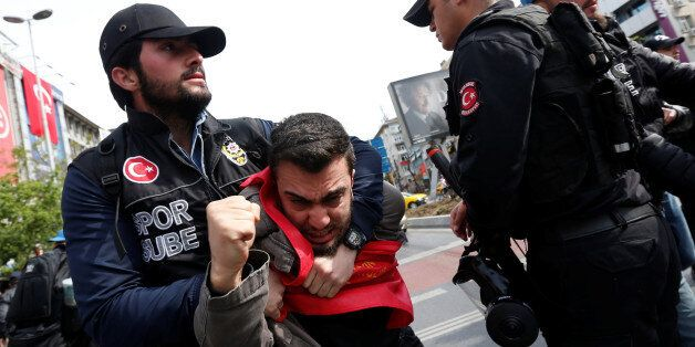 Turkish riot police scuffle with a group of protesters as they attempted to defy a ban and march on Taksim...