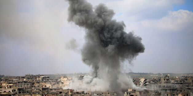 Smoke billows following a reported air strike on a rebel-held area in the southern Syrian city of Daraa,...