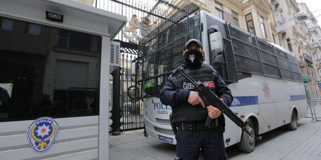 A Turkish riot police stands guard in front of the Dutch Consulate in Istanbul, Turkey, March 11, 2017....