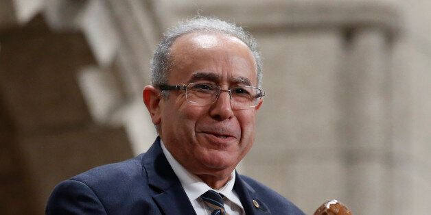 Algeria's Foreign Minister Ramtane Lamamra reacts while being recognized by the Speaker in the House...
