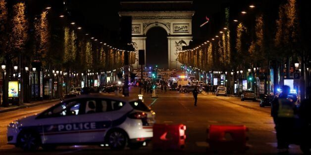 Police officers block the access to the Champs Elysees in Paris after a shooting on April 20, 2017.One...