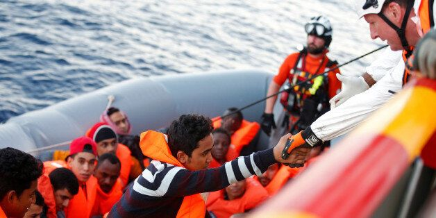 Migrants are seen during rescue operation in the Mediterranea Sea October 20, 2016. Yara Nardi/Italian...