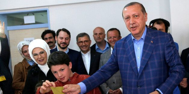 Turkish President Tayyip Erdogan casts his ballot at a polling station during a referendum in Istanbul,...
