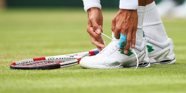 LONDON, ENGLAND - JUNE 26: a detail shot of Lukas Rosol of Czech Republic tying his shoelace during his...