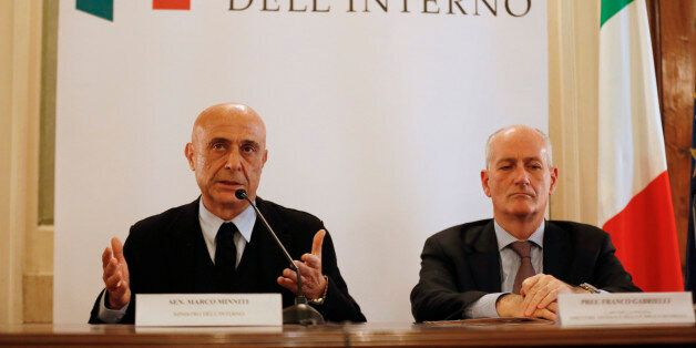 Italian Interior Minister Marco Minniti (L) and cheif of police Franco Gabrielli attend a news conference...
