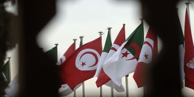 A general view shows Algerian and Tunisian flags during the welcome ceremony for the Tunisian president...
