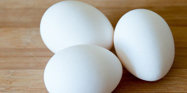 TORONTO, ONTARIO, CANADA - 2015/03/30: Eggs: realistic approach to food ingredients. Three white eggs...
