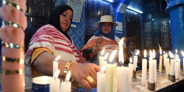Jewish pilgrims light candles in the Ghriba synagogue on the Mediterranean resort island of Djerba on...