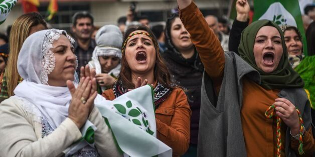 TOPSHOT - Women flash the victory sign during the Newroz celebrations for the new year on March 21, 2017...