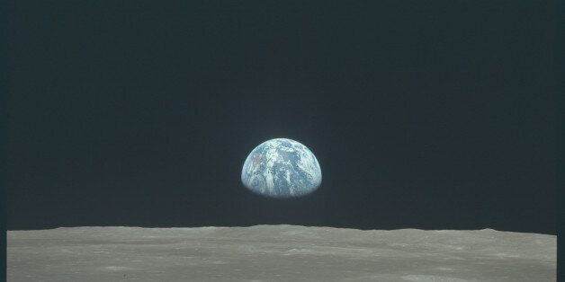 Earth rises above the moon's horizon during the Apollo 11 lunar mission in this July 1969 NASA handout...