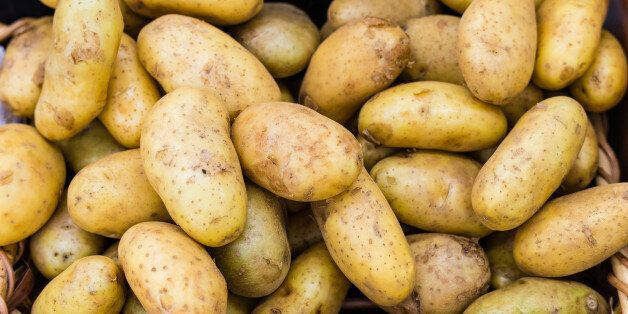 Fresh organic potatoes resting in the wooden