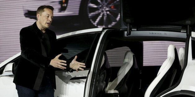 Tesla Motors CEO Elon Musk introduces the falcon wing door on the Model X electric sports-utility vehicles...