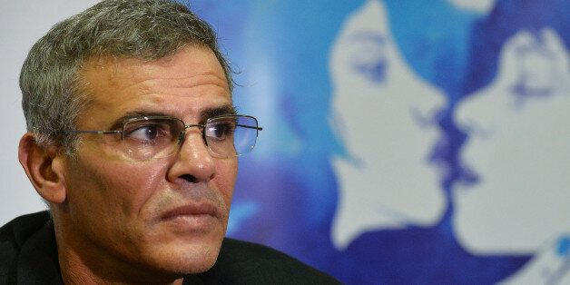(To go with AFP interview by Anca Teodorescu) French Tunisian director Abdellatif Kechiche looks on during...