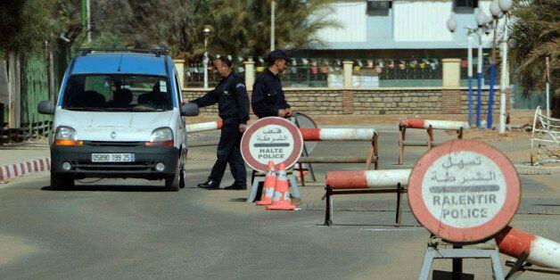 Algerian policemen stop cars at a checkpoint in In Amenas, deep in the Sahara near the Libyan border,...