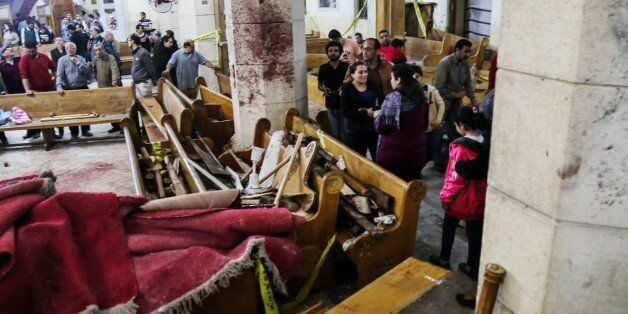 TANTA, EGYPT - APRIL 9: People are seen at the damaged Saint George church after a bombing struck inside...