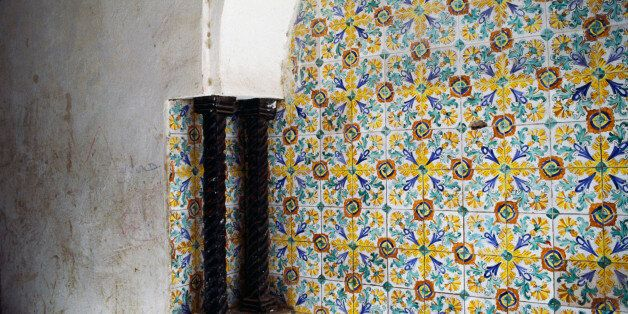 ALGERIA - MAY 05: Wall decorated with floral pattern tiles and two twisted columns, Kasbah of Algiers...
