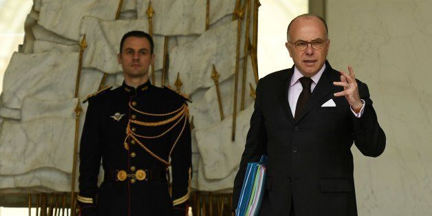 French Prime Minister Bernard Cazeneuve leaves after a cabinet meeting at the Elysee Palace, in Paris,...