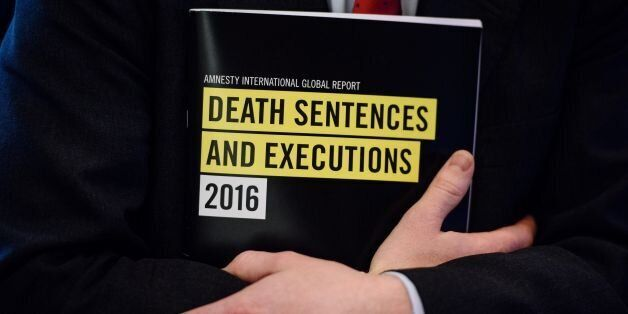 In this photo taken on April 10, 2017, a global report booklet by Amnesty International entitled 'Death...