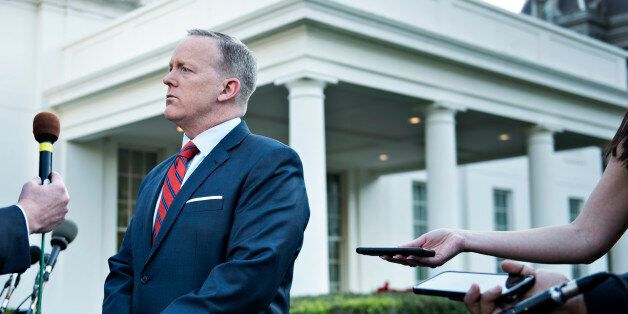 White House Press Secretary Sean Spicer speaks to a reporter about a comparison he made between Syria's...