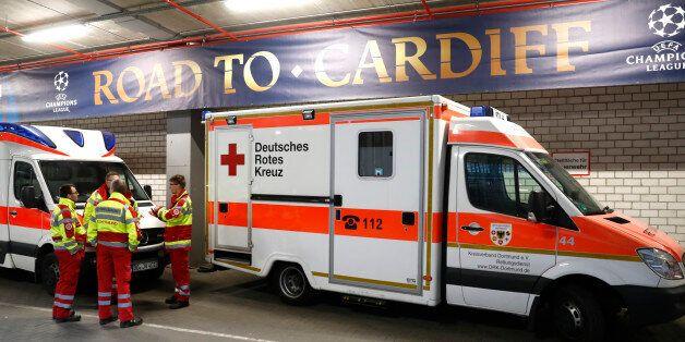 Ambulances are pictured inside stadium after the team bus of Borussia Dortmund had some windows broken...