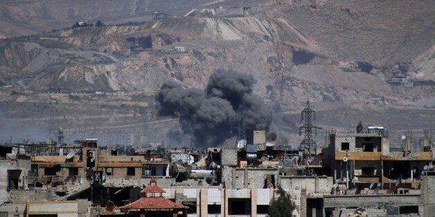 DAMASCUS, SYRIA - APRIL 5: Smoke rises after the war crafts belong to Assad Regime forces carried out...