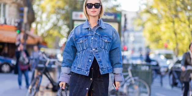 PARIS, FRANCE - OCTOBER 03: Pernille Teisbaek wearing a denim jacket and Chanel bag outside Hermes on...