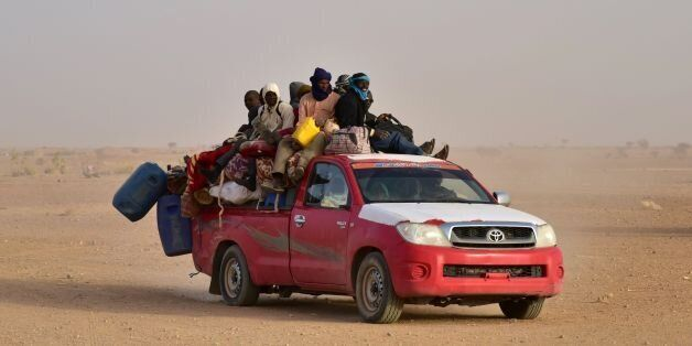 West African people coming back to Niger after fleeing Libya due to armed groups, arrive on a pick up...