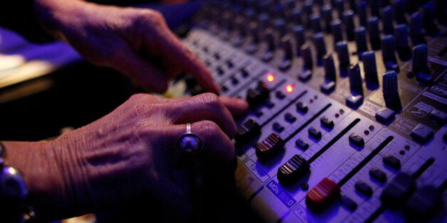 DJ Wika Szmyt controls the sound mixer as she plays music at a club in Warsaw January 4, 2012. Szmyt,...